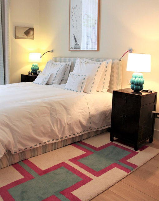 Tufted rugs in a bedroom
